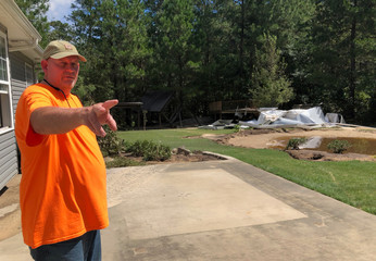 James Williford surveys his flood-damaged backyard in Hope Mills, a suburb of Fayetteville