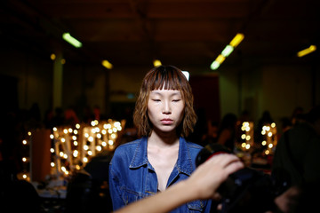 Models prepare backstage of the Natasha Zinko catwalk show during London Fashion Week in London