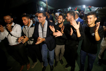 Men celebrate during the engagement ceremony of Palestinian Mahmoud Al-Balbol in the Bedouin village of Khan al-Ahmar, in the occupied West Bank
