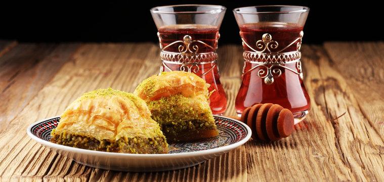Turkish Dessert Baklava with pistachio on wooden table.
