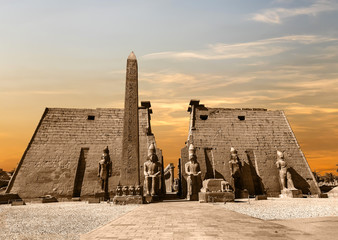 Entrance to Luxor Temple at sunset, a large Ancient Egyptian temple complex located on the east bank of the Nile River in the city today known as Luxor (Thebes). Was consecrated to the god Amon-Ra