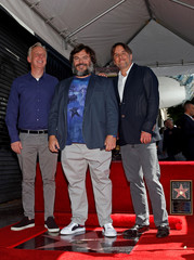 Actor Jack Black poses with actor Mike White and director Richard Linklater at the unveiling of his star on the Hollywood Walk of Fame in Los Angeles