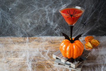 Bloody Mary cocktail, pumpkin with bats and spiders for Halloween, selective focus Copy space