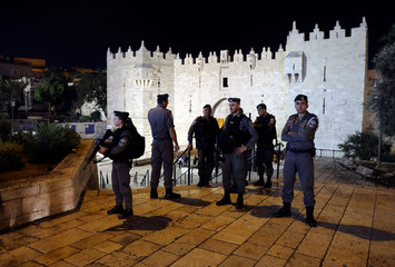 Israeli security forces stand guard at Jerusalem's Damascus Gate after a suspected stabbing attack