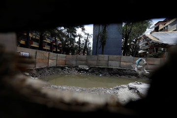 A general view shows buildings in the Tlalpan neighbourhood which were damaged by the devastating earthquake, that took place in Mexico City last year