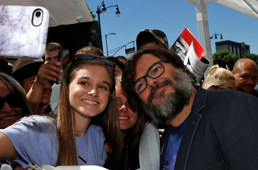 Actor Jack Black poses for selfies at the unveiling of his star on the Hollywood Walk of Fame in Los Angeles