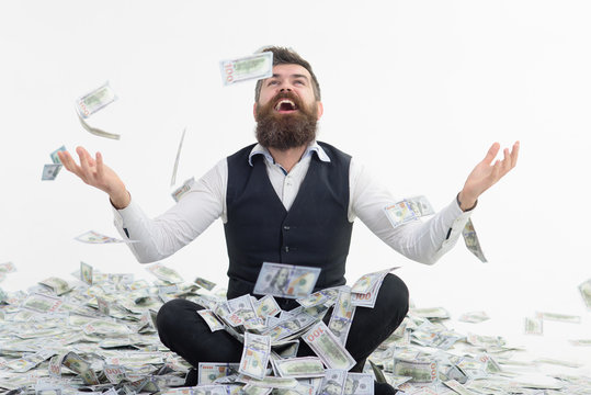 Businessman throwing dollars. Dollars raining. Millionaire man. Richness&wealth concept. Successful entrepreneur wasting money. Banker increase profit. Lottery jackpot. Happy bearded man throws money.