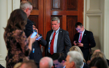 White House Deputy Chief of Staff for Communications Shine waits for start of joint news conference at the White House in Washington