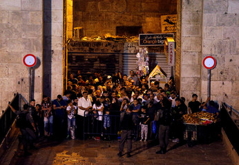 Israeli police secure the entrance to JerusalemÕs Old City, near the site of a suspected stabbing attack