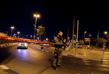 Israeli security forces seal off a street near Jerusalem's Damascus Gate after a suspected stabbing attack