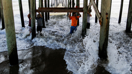 Rodanthe pier is seen partially damaged after the pass of Hurricane Florence, now downgraded to a tropical depression in Rodanthe, North Carolina