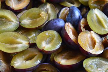 Close up of fresh plum slices. Plum slices background