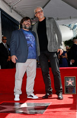 Actor Jack Black poses with Tim Robbins at the unveiling of his star on the Hollywood Walk of Fame in Los Angeles
