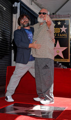 Actors and musicians Jack Black and Kyle Gass of Tenacious D pose at the unveiling of Jack Black's star on the Hollywood Walk of Fame in Los Angeles