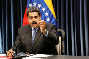 Venezuela's President Nicolas Maduro gestures as he talks to the media during a news conference at Miraflores Palace in Caracas