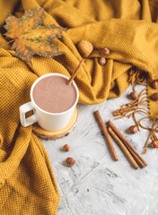 White Cup of Hot Chocolate, Yellow Plaid, Leaves, Gray Background, Autumn Concept, Cosiness, Instagram Style