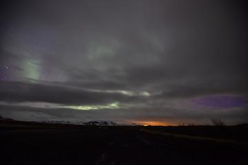 The Northern Lights illuminate the Icelandic landscape