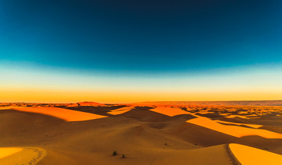 Sunrise in the Sahara desert next to M'hamid in Morocco