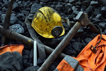 Candle with the miner belongings (helmet, gloves, pickaxe, vest, belt)