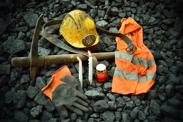 Vigil light, candle with the miner belongings (helmet, gloves, pickaxe, vest, belt)
