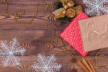 Christmas and New Year holiday background. Christmas decor on a wooden table. Top view, copy space