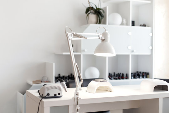 Nail care. Light studio for manicure with a tool