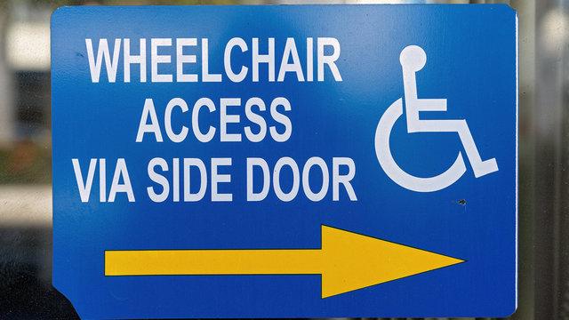 Wheelchair Access Sign On A City Shop Window