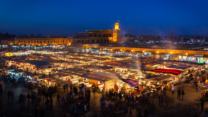 Crowd in Jemaa el Fna square at sunset, Marrakech, Morocco.