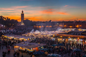 Crowd in Jemaa el Fna square at sunset, Marrakesh, Morocco