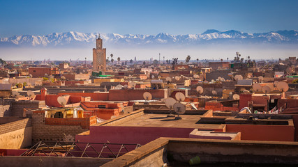 Poster Morocco Panoramic view of Marrakesh and the snow capped Atlas mountains, Morocco