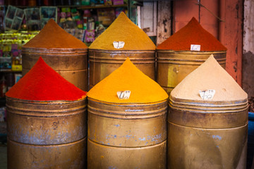 Colorful piles of powdered spices for sale in Marrakesh souq, Morocco