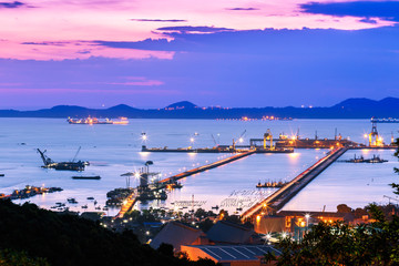 Dramatic Sky burst over Sriracha harbor port Chonburi Thailand, long exposure technic therefore smooth water surf