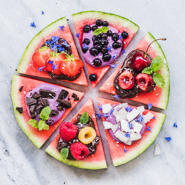 Watermelon pizza with fruit, chocolate and yogurt toppings