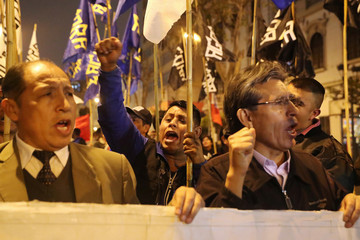 Demonstrators attend a protest to support Peru's President Martin Vizcarra after he asked the Congress for a new vote of confidence in his Cabinet in Lima