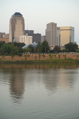 The Red River meanders by under bridges and by the waterfront in Shreveport Louisiana