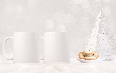 2 white blank coffee mugs Christmas theme mock up.