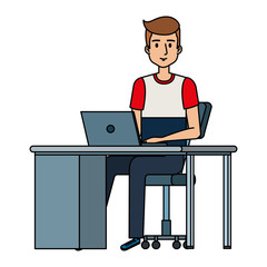 young man at desk with laptop