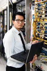 handsome business man engeneer in datacenter server room