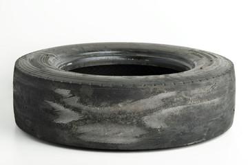 Worn truck wheel on white background. Types of wear Wheels.