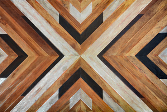 seamless yellow, black, white and dark brown color lumber in arrows or chevron pattern to the center for texture background. top view