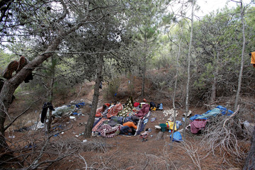 African migrants sleep in their hiding place in the Moroccan mountains near the city of Tangier
