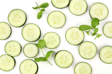 Cucumber slices and mint leaves on white, a fresh background