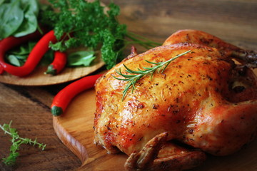 Whole roasted chicken on cutting board