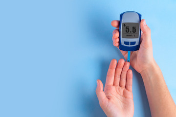 The diabetic measures the level of glucose in the blood. Diabetes concept. Copy space. Diabetes