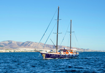 A nice beautiful wooden hull floating in blue waters of Saronic gulf. Piraeus, Greece.