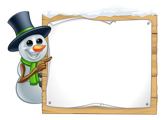 A snowman Christmas cartoon character pointing at a wooden sign
