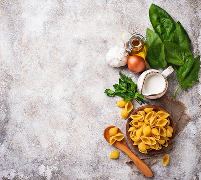 Ingredients for cooking  pasta with spinach