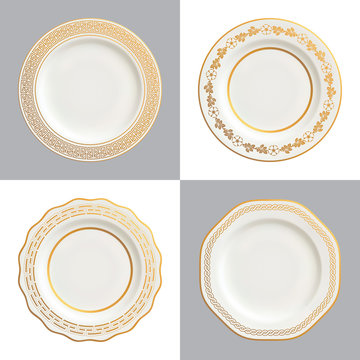 Vector illustration of decorative white plates with gold trims and ornamental borders; isolated on white and dark backgrounds.