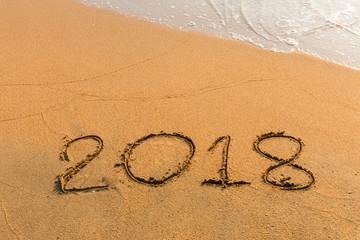 abstract  2018 on a beach sand