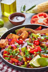 Tasty warm mexican salad with fried tofu, vertical